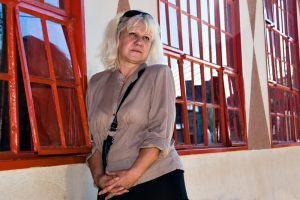casual middle age woman against red windows. People diversity series